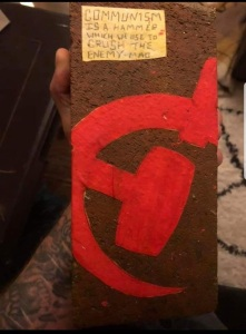 picture of brick held by fascist posted on fascists social media