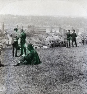 Striking workers watching over the mill from the hillside
