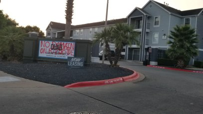 'No Domain On Riverside' on the Front Entrance to the Quad Apartments