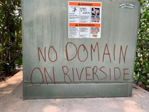 'No Domain On Riverside' written on an electrical box.