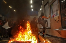 Protesters set fire and vandalize Metro station.