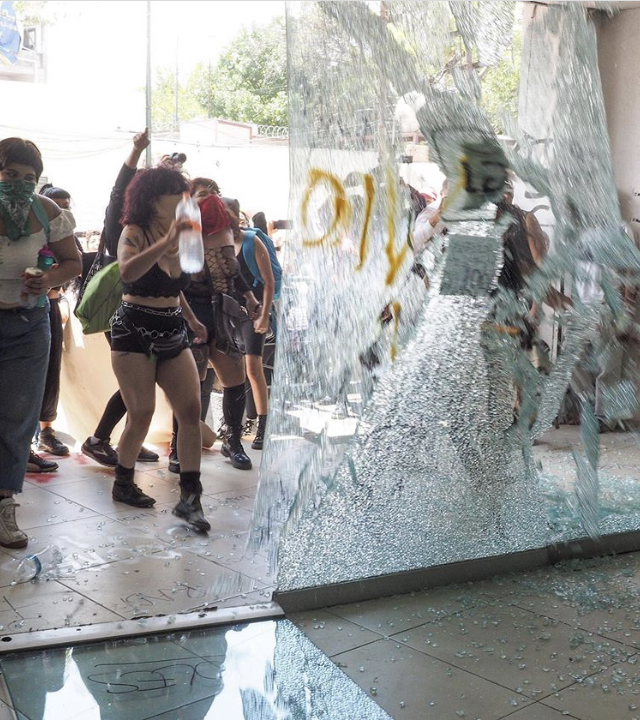 Protesters break glass at Attorney General's office.