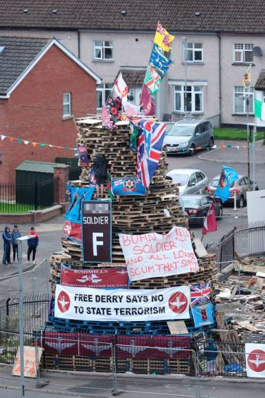 Bonfire draped in British flags
