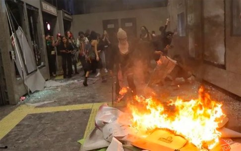 Protesters set fire inside metro station.