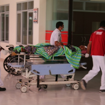 Police injured during Wednesday protests is transported to a hospital