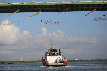 Greenpeace activists hang above channel