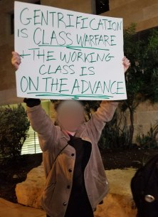 "Sign reading ""Gentrification is Class Warfare & The Working Class is On the Advance"""