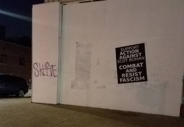 Large poster calling on masses to combat and resist fascism