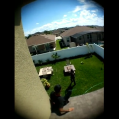 Torres moments before being pushed off roof.