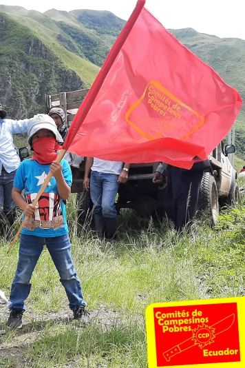 A Child carries the flag of the Committee of Poor Peasantss