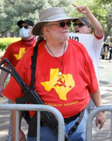 David Michael Smith, a leader of the Houston Socialist Movement, open carrying at a protest.