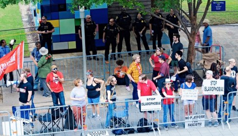 The Houston Socialist Movement in a police-created protest pen set behind barricades this past September