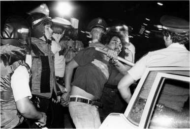Police arrest a Chicano Protester