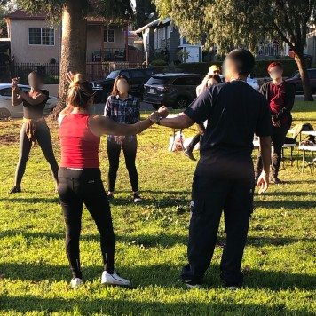 Attendees participate in a self-defense seminar