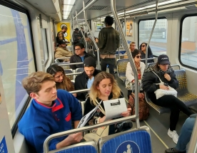 Train riders reading Incendiary