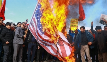 Iranians burn a US flag.