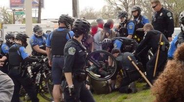 Austin police trap marchers.
