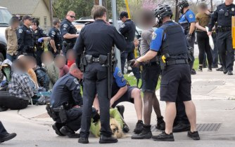 Police brutally arrest photographers who were standing nearby